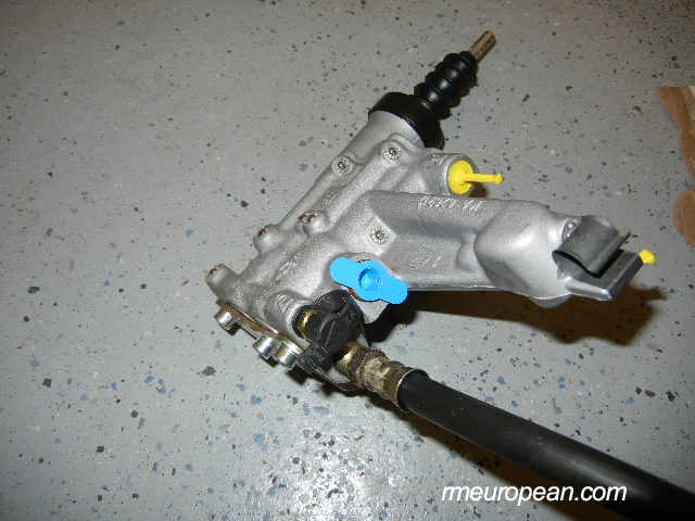 Porsche 996 Turbo Clutch Slave Cylinder Replacement - New clutch slave with hose attached