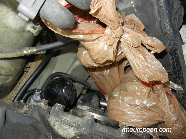Porsche 996 Turbo Clutch Slave Cylinder Replacement - Hoses covered with plastic