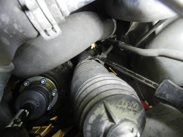 996 Turbo Removing the steering rack boot.