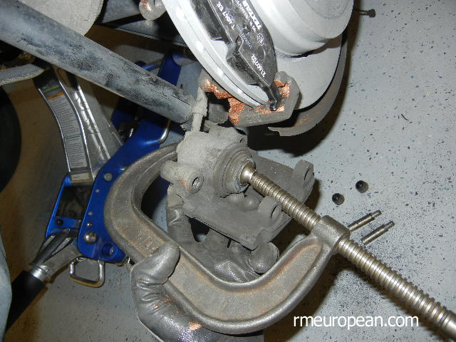 BMW E46 Brake Replacement - Compressing the brake caliper piston.
