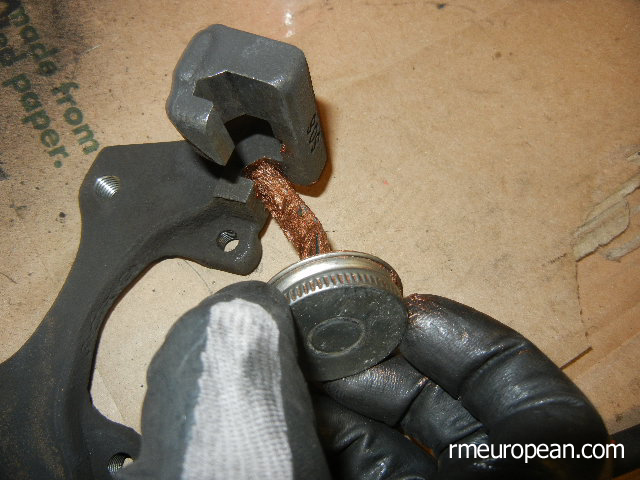 BMW E46 Brake Replacement - Lubricating the brake caliper bracket.