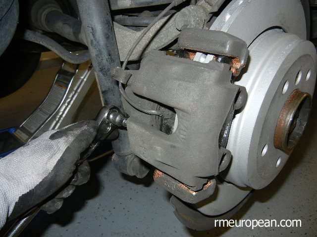 BMW E46 Brake Replacement - Brake caliper installed with new brake pads.