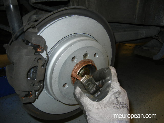 BMW E46 Brake Replacement - Lubricating the wheel hub.