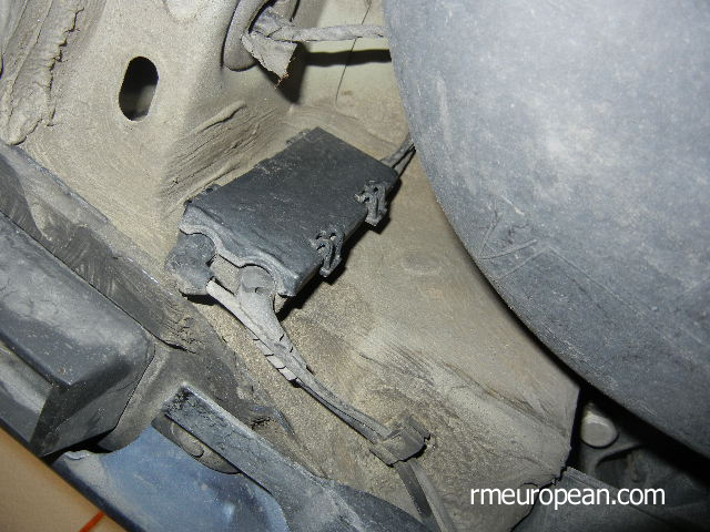 BMW E46 Brake Replacement - Removing the brake pad wear sensor.