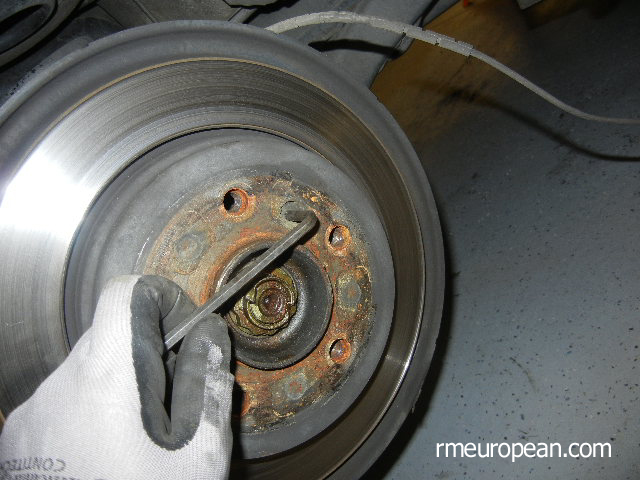 BMW E46 Brake Replacement - Removing the brake rotor set screw.