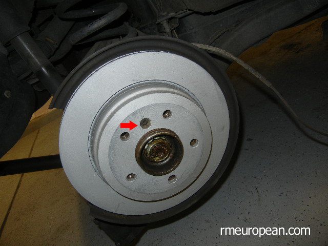 BMW E46 Brake Replacement - New brake rotor installed.