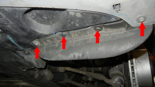 BMW E90 Headlight Washer Replacement - Removing screws for front fender liner.