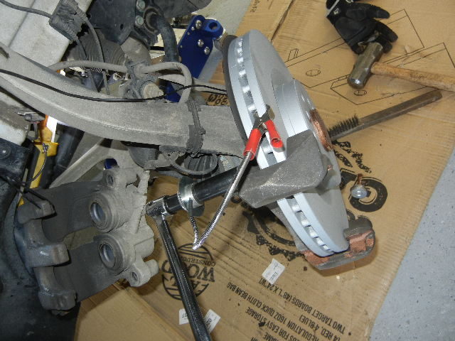 Mercedes GL450 bolting up the caliper bracket.
