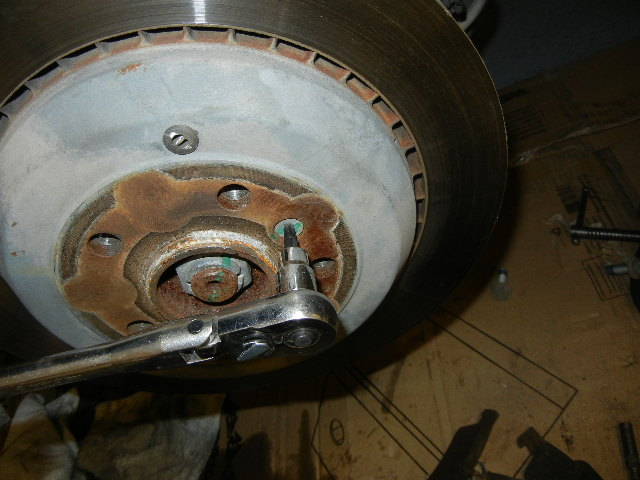 Mercedes GL450 removing the brake rotor set screw.