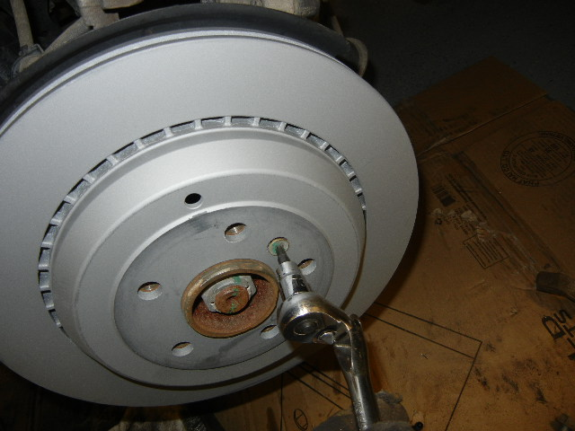 Mercedes GL450 installing the brake rotor screw.
