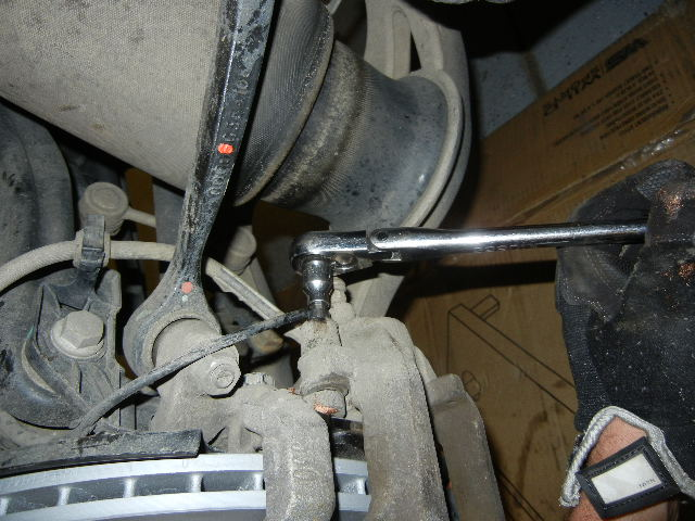 Mercedes GL450 installing the brake caliper.