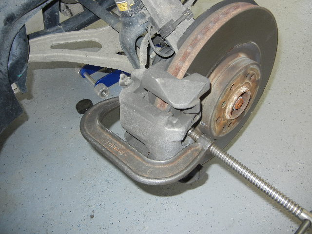 Mercedes GL450 compressing the brake caliper piston.
