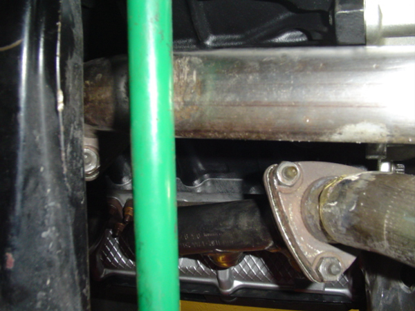 BMW E30 M50 Downpipes next to the subframe.