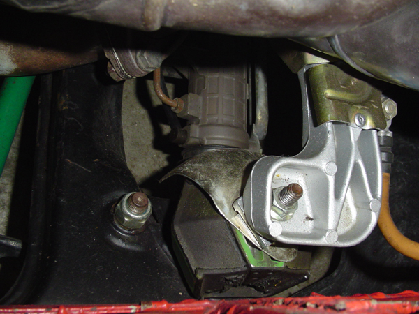 Engine mount spacer installed to raise the engine.