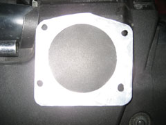 Custom fabricated spacer to use on the OBD1 manifold