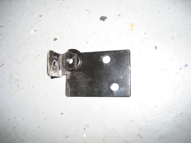 Modified oil dipstick tube bracket