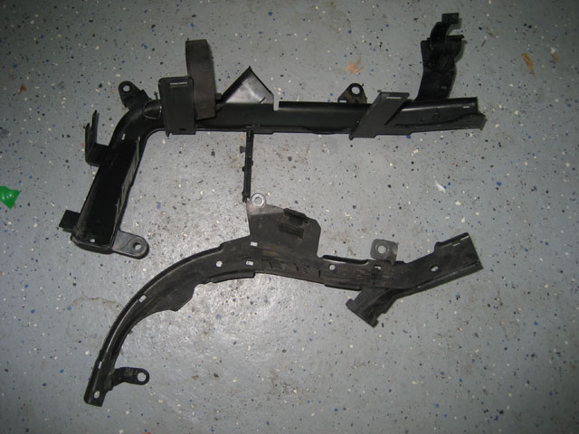 Comparison of OBD1 and OBD2 wiring harness brackets.